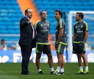 MADRID, SPAIN - AUGUST 18: Head coach Rafael Benitez (L) speaks with assistant coach Antonio Gomez (2ndL), second assistant coach Fabio Pecchia (2ndR) and Pgisical coach Paco de Miguel (R) before the Santiago Bernabeu Trophy match between Real Madrid CF and Galatasaray  at Estadio Santiago Bernabeu on August 18, 2015 in Madrid, Spain.  (Photo by Gonzalo Arroyo Moreno/Getty Images)